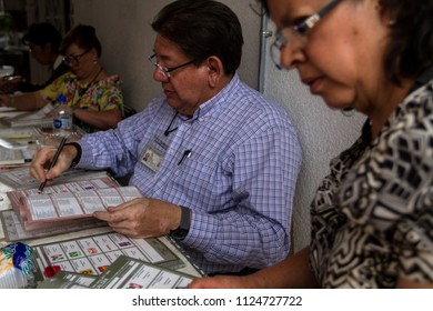 Mexico City. July 1, 2018. Electoral representatives destroy the remaining electoral ballots after the polling place was closed, during the presidential election.