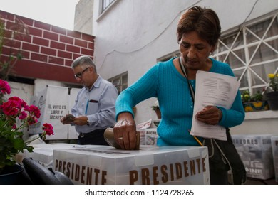 Mexico City. July 1, 2018. A woman votes during the mexican presidential election.