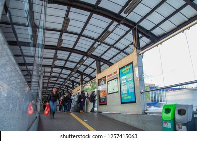 Mexico City - July 12, 2018: entrance hall of a public transport station Metrobus with people entering and leaving on a work day