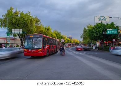 Mexico City - July 12, 2018: panoramic view of the insurgents avenue that crosses the city and a public transport car metrobus in the foreground