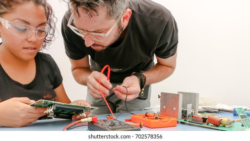 MEXICO CITY, MEXICO - July 15th 2017: Two students working on a electronic project at tech school