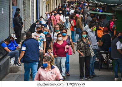 Mexico City, Mexico ; July 28 2020: People walking in downtown mexico city some with face masks and some not during the new normal post covid 19