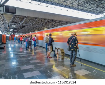 Mexico city - June 10, 2018: Panoramic view of a metro station in Mexico City, people waiting on the platform