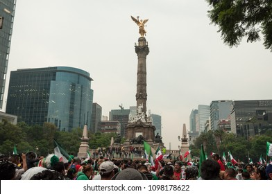 Mexico City / Mexico - June 23 2014: Celebration of the victory of Mexico vs Croatia during the 2014 FIFA World Cup at the Angel of Independence. This winning was the pass of Mexico to Round 16.