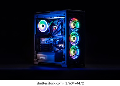 Mexico, Mexico City - June 24, 2020: Professional workstation and gaming computer, to play video games online or do professional design and multimedia work. In a room with colorful neon led lights.