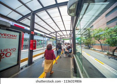 Mexico city - June 25, 2018: panoramic view of people walking inside a metrobus station in Mexico City on a sunny day