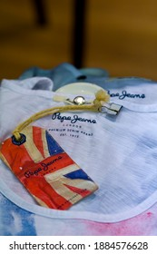 MEXICO CITY - June 27, 2014: Pepe Jeans brand shirts in fashion store. Pepe Jeans London is a denim and casual wear jeans brand established in the Portobello Road area in 1973.