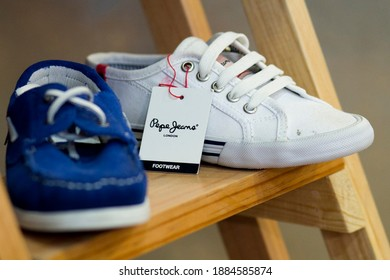 MEXICO CITY - June 27, 2014: Pepe Jeans brand fabric sneakers in fashion store. Pepe Jeans London is a denim and casual wear jeans brand established in the Portobello Road area in 1973.
