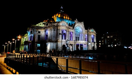 Mexico City, Mexico, June  29 - 2019, Side view of the Palacio de Bellas Artes (Palace of Fine Arts) at night, with lights illuminating its external walls highlighting its architecture