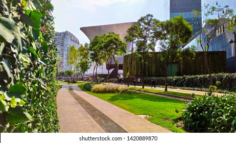Mexico City, June 6, 2019: The Soumaya Museum in the background, with more than 66,000 works of art dating back more than 30 centuries, is located in Polanco, Mexico. You can see the garden around