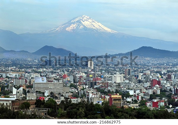 MEXICO CITY - MAR 01 2010:Popocatepetl volcano mountain raise above Mexico city.It's the most active volcano in Mexico with more than 15 major eruptions since the arrival of the Spanish in 1519.