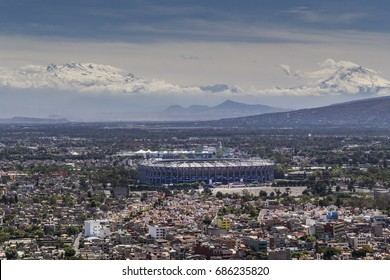 MEXICO CITY - March 16, 2015: aerial view of countries biggest stadium, Estadio Azteca, venue for many events and concerts, located in the south and in the back volcanoes surrounding the metropolis