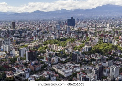MEXICO CITY - March 16, 2015: aerial view of overcrowded urban city with world trade center building and middle class neighborhood