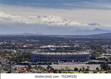 Mexico City, March 16, 2015: aerial view of aztec stadium, biggest one of Mexico, home to team America, with snowed volcano behind