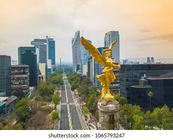 Mexico City - March 17, 2017: frontal aerial view of the statue of the angel of independence on Reforma Avenue with Chapultepec forest in the background