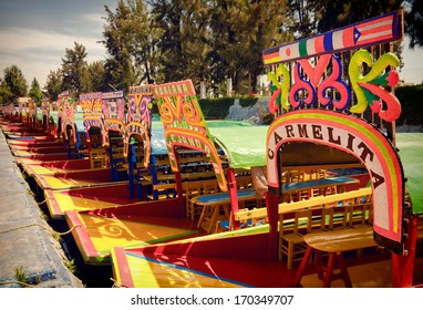 MEXICO CITY - MARCH 17: Colorful boats parked on a canal in Xochimilco Floating Gardens of Mexico on March 17, 2011 in Mexico City, Mexico. System of canals in Mexico City measures about 170 km.