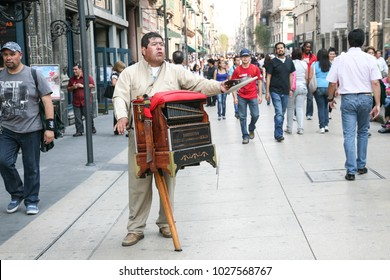 Mexico city, Mexico - march 3d, 2012: Man playing street barral organ on a Calle Francisco I.Madero in Hictorical center of Mexico City, Mexico DF