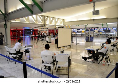 MEXICO CITY - MAY 1: Departing passengers are questioned about their health and screened for fever by officials  at the Benito Juarez Airport on May 1, 2009 in Mexico City.