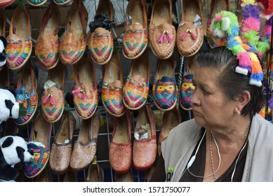 Mexico City, Mexico - May 10, 2019: Group of colorful Indian-designed sandals made of leather, for sale by a local merchant in Chapultepec Forest, Mexico City.