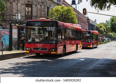 MEXICO CITY, MEXICO - MAY 19, 2019: Red bus public transport driving along the city.