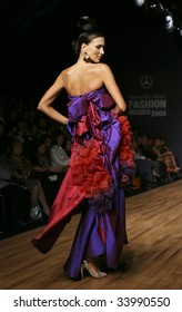 MEXICO CITY - MAY 21: A model walks the runway wearing Sebastian y Marialuisa Autumn/Winter 2009 during Mercedes-Benz Fashion Mexico Autum/Winter 2009 May 21, 2009 in Mexico City.