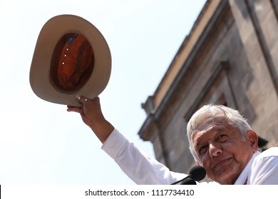 """Mexico City May 24 2018 Andrés Manuel López Obrador, presidential candidate of """"Together we make history"""" coalition of political parties speaks in a podium to his supporters in a meeting."""
