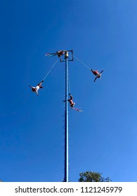 MEXICO CITY, MEXICO- May 27, 2018: The Voladores dressed in traditional clothing perform Dance of The Flyers for tourists in a park in Mexico City.