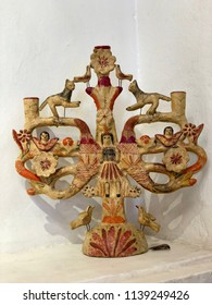 MEXICO CITY, MEXICO - May 27, 2018: Vintage Mexican Tree of Life candelabra, made of clay.