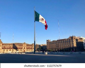 MEXICO CITY, MEXICO - May 28, 2018: Mexican flag on Zocalo also known as Plaza de Constitucion - the main square in the center of Mexico City.