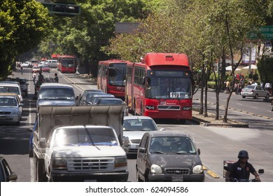 Mexico City, Mexico- May 30, 2012: View of a row of Line 1 Metrobuses heading to Caminero at a the Insurgentes Avenue. Insurgentes is considered the longest avenue in the world.