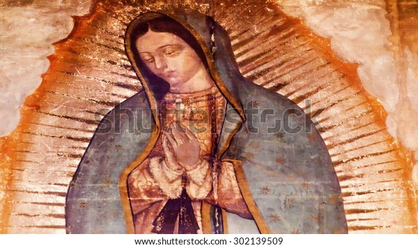 MEXICO CITY, MEXICO-DECEMBER 25, 2015 Original Virgin Mary Guadalupe Painting which was revealed by Indian Peasant Juan Diego 1531 to Catholic Bishop. New Shrine of the Guadalupe, Mexico City Mexico