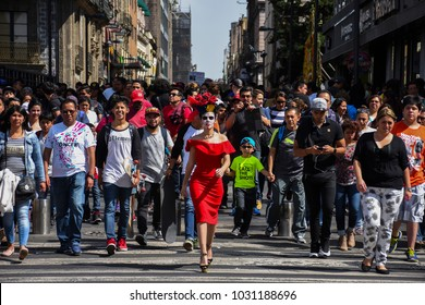 Mexico City, Mexico - November 02 2016: Gabriela Avila dress up as a katrina crossing Madero street on the day of the dead in downtown Mexico City