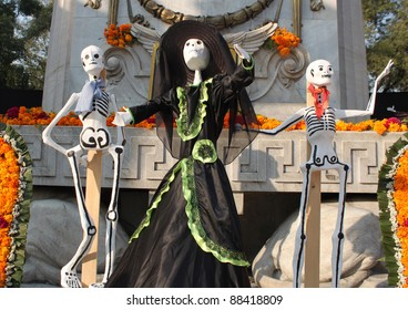 MEXICO CITY - NOVEMBER 1: Offering of the day of the dead in the park Alameda, skeletal representation of women traditional Mexican clothing. November 1, 2011. Mexico City