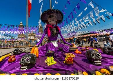"Mexico City / Mexico - November 4, 2017.  The Zocalo, main square of Mexico City. Skeleton model of ""Catrina"" involved of installation to celebrate the Day of the Dead holiday"