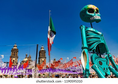 Mexico City / Mexico - November 4, 2017. The Zocalo, main square with the Metropolitan Cathedral in the background. Skeleton model involved of installation to celebrate the Day of the Dead holiday