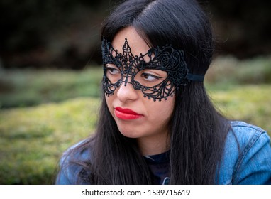 Mexico City / Mexico - November 4, 2018: A young woman with face paint and makeup celebrates Dia De Los Muertos or day of the dead in Mexico.