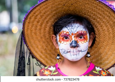 MEXICO CITY - OCT 23: Unknown participant on a Parade of Catrinas in Paseo de la Reforma Avenue, Mexico, on October 23 2016. The Day of the Dead is one of the most popular holidays in Mexico