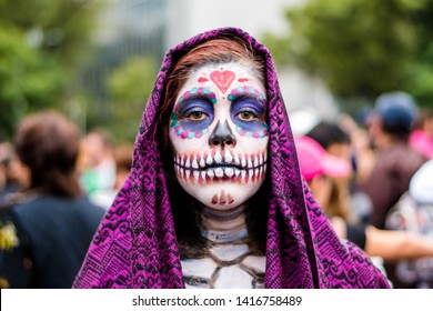MEXICO CITY - OCT 23/2016: Unknown participant on a Parade of Catrinas in Paseo de la Reforma Avenue, Mexico, on October 23 2016. The Day of the Dead is one of the most popular holidays in Mexico