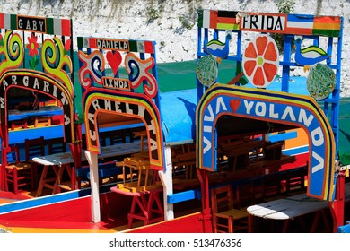 Mexico City, Mexico - Oct 5, 2016. Colorful trajineras or boats await tourists to take them on tour of Lake Xochimilco channels. UNESCO World Heritage Site in Mexico City.