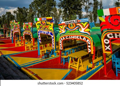 MEXICO CITY, MEXICO - OCTOBER 13, 2016: Colourful Mexican boats with women names at Xochimilco's Floating Gardens