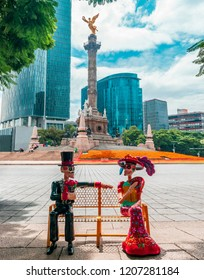 Mexico city, October, 18, 2018: Traditional Mexican dolls and famous landmark