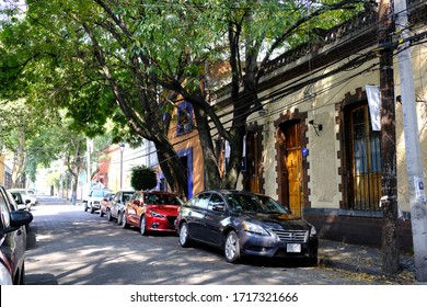 Coyoacán, Mexico City, Mexico - October 2019 : A local long and narrow road with unique architecture in Coyoacán (Place of Coyotes), Mexico City, Mexico.