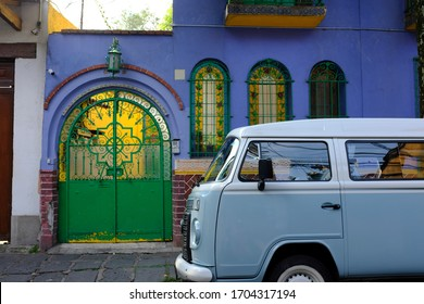 Coyoacán, Mexico City, Mexico - October 2019 : A pastel blue vintage van parking in front of a colorful house in Coyoacán (Place of Coyotes), Mexico City, Mexico.
