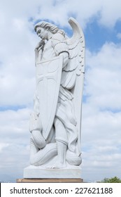 MEXICO CITY, MEXICO - OCTOBER 23, 2014: A beautiful tall marble statue of the Archangel Michael stands on top of Tepeyac Hill under a cloudy sky near the Basilica of Guadalupe in Mexico City