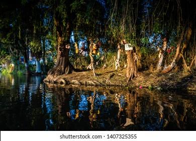 Mexico City, Mexico - October 24, 2018. Cana in quarter Xochimilco, Isla de las munecas, Island of Dolls, with legend about dead girl