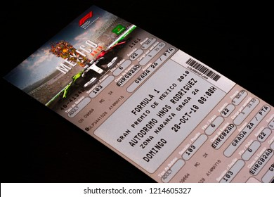 Mexico City, Mexico - October 28, 2018: Shot of a ticket to attend the Formula 1 2018 Grand Prix in Mexico City, Mexico shot against a black background.
