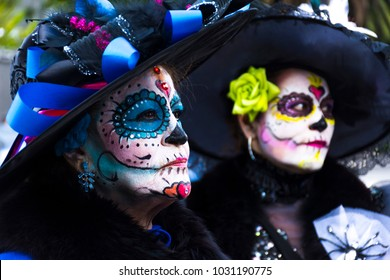 Mexico City, Mexico - October 29,2016: two ladies dress up as katrinas stop for people take pictures of them in the parade on Reforma Avenue on the day of the Dead