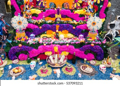 MEXICO CITY, MEXICO - OCTOBER 31, 2016: Day of the Dead Offering Altar Gifts For the Afterlife at Casa Azul, the Home of Frida Kahlo in Mexico City
