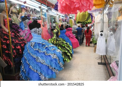 MEXICO CITY, MEXICO - OCTOBER 7, 2012  A shop  in the center of Mexico City, Mexico with traditional dresses for the celebration of a girl's fifteenth birthday. People visible in the background.