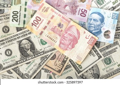 MEXICO CITY / MEXICO - SEPTEMBER 14 2015: Dollar and Mexican Peso exchange rate, assorted bills cash pile background